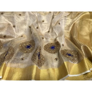 Cream tissue linen saree with gold and blue embroidery