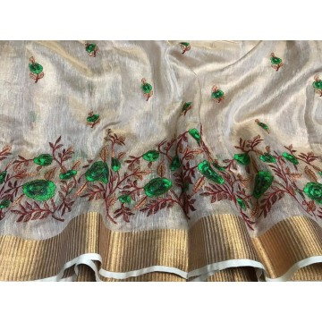 Cream tissue linen saree with green floral embroidery