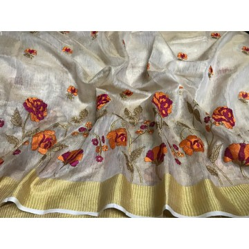 Cream tissue linen saree with orange floral embroidery