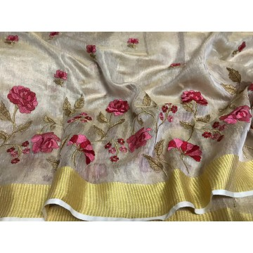 Cream tissue linen saree with pink floral embroidery
