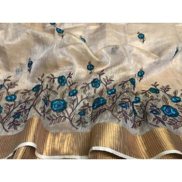 Cream tissue linen saree with turquoise floral embroidery