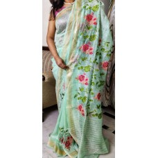 Light green linen-silk saree with floral embroidery