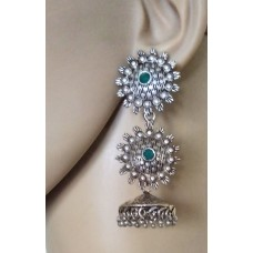 Silver tone jhumkas with green stone