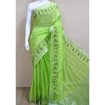 Lime green linen saree with musical notes embroidery