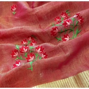 Melon red tissue linen saree with floral embroidery