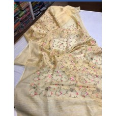 Pale yellow linen-silk saree with floral embroidery