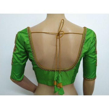 Parrot green blouse with hand embroidery (size 36, can be extended to size 40)