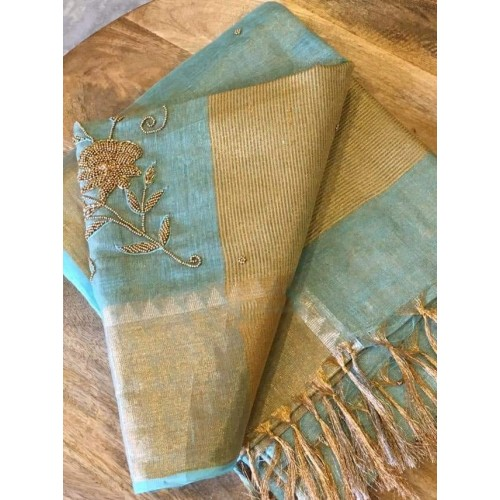 Seagreen tissue linen saree with hand embroidery