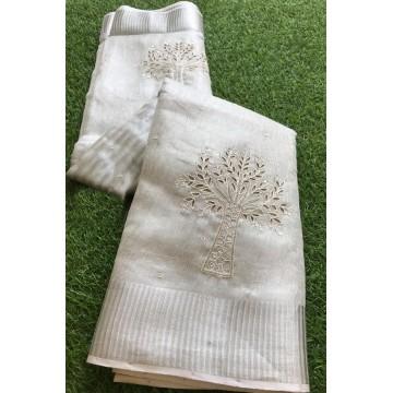 Silver tissue linen saree with cutwork tree motif