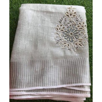 Silver tissue linen saree with cutwork and pearl embroidery
