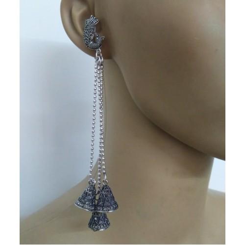 Silver tone triple strand long earrings