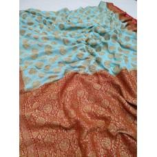 Turquoise and red Khaddi Banarasi chiffon saree with antique gold zari
