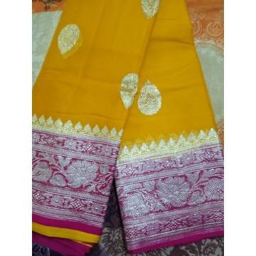 Yellow and magenta handwoven Banarasi chiffon saree with silver zari